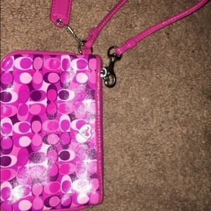 Coach pink and white leather wristlet